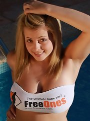 Big boobed 18 year old Tegan Brady gets wet in the swimming pool