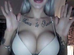 Classic Tattoed Bimbo With Giant Fake Tits