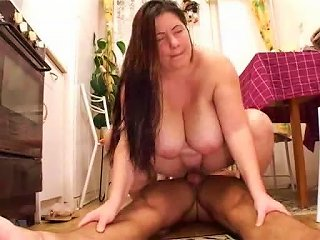 Long-haired Brunette Gets Her Holes Drilled In The Kitchen