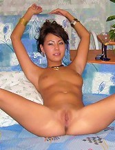 Sweet Asian Exgirlfriend is showing her tight shaved pussy on sofa