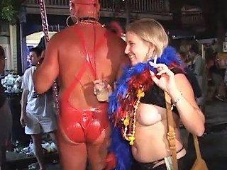 Randy Lesbians In Mardi Gras Party Kissing In Public
