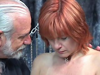 Mature Redheaded Slave With Saggy Tits Is Whipped In