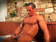 Muscle stud Jiri Lasik strokes his muscle dick in jacuzzi