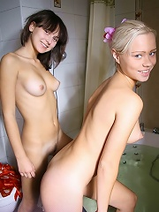 Juliya invites Irina to get into the bath together. She likes to play with water. Perfect close-ups inside.