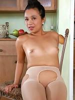 Classy Asian milf Lucky Starr fucks herself with a dildo on a chair