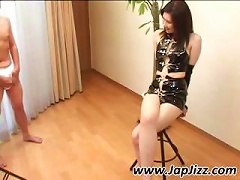 Asian Chick In Latex Sucks On A Cock That S In Her Armpit