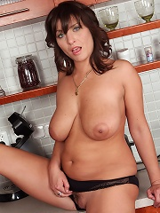 Sexy brunette housewife gets naked and spreads in the kitchen
