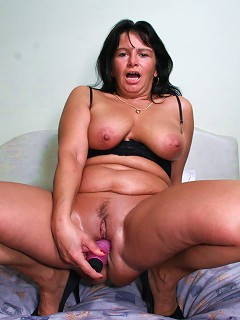 Naughty mature slut playing with her pussy