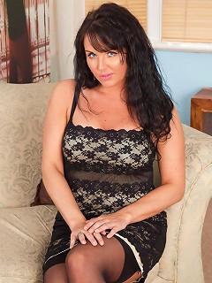 Milf Leah peels off her black dress exposing her bra and thong