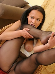 Doll-faced gal exposing her feet in black pantyhose and high heel sandals