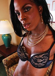 Dark skinned T-girl shows he...