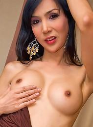 Stockinged Asian ladyboy Khem squeezing her cock