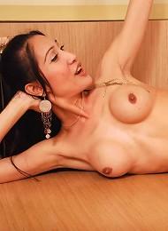Slender ladyboy gets naked and masturbates