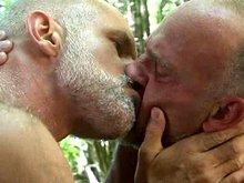 Mature gay daddies have fun outdoors