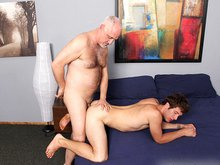 Mature daddy have fun with a young and hung jock