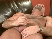 Hairy daddy gets naked and masturbates his mature dick