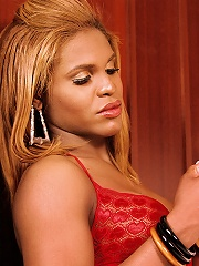 Big titty black shemale dressed to kill in red