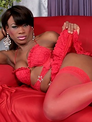 Naughty shemale model in sexy pink outfit